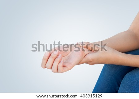 Woman holding her wrist, pain concept, Office Syndrome. - stock photo