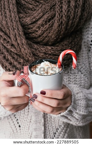 Woman holding hot chocolate with whipped cream - stock photo