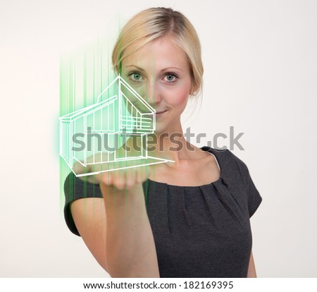 Woman holding house on hand - stock photo