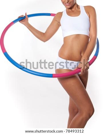 Woman holding hula hoop - Hula Hoop Exercises - stock photo