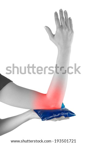 Woman holding ice gel pack on elbow. Medical concept photo.  - stock photo