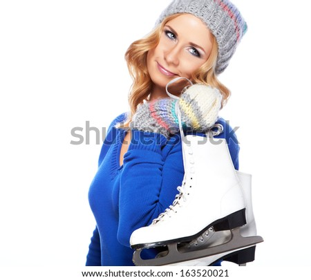 Woman holding ice skates for winter ice skating sport activity in  hat smiling isolated on a white background  - stock photo
