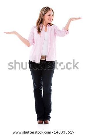 Woman holding imaginary objects in the palm of her hands - isolated over white  - stock photo