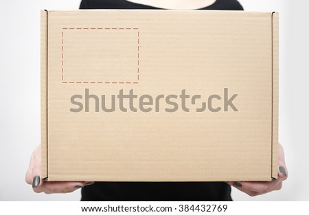 Woman holding in hands carton box closeup. - stock photo
