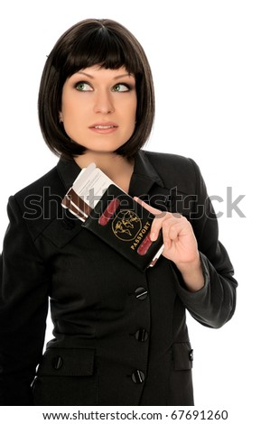 Woman holding in the hand passport and airline tickets for business trip - stock photo