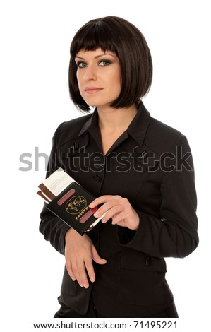Woman holding in the hand passport and tickets for business trip - stock photo