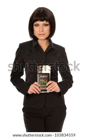Woman holding in the hand passport for a business trip - stock photo