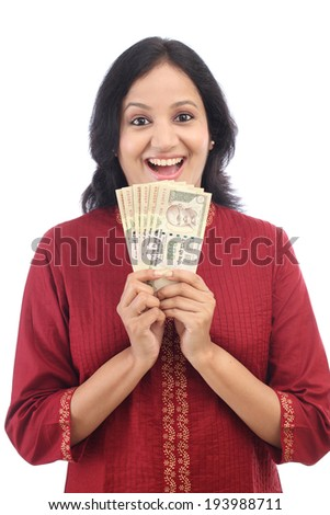 Woman holding Indian currency notes against white background  - stock photo