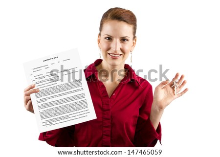 Woman holding keys and a deed of sale contract - stock photo