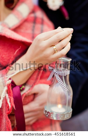 woman holding lantern with candle - stock photo