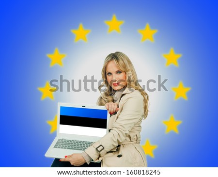woman holding laptop with estonian flag on the screen and european union stars in the background - stock photo