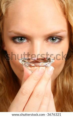 Woman Holding Large Briliant Cut Diamond: Stone in Focus - stock photo