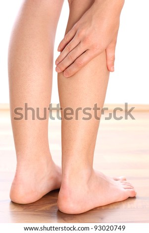 Woman holding leg - stock photo