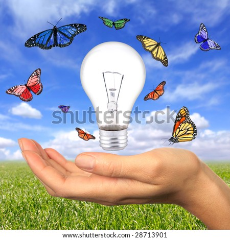 Woman Holding Lighbulb Concept of Clean Renewable Energy of the Future - stock photo