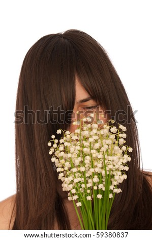 Woman holding lily of the valley in the hand - stock photo