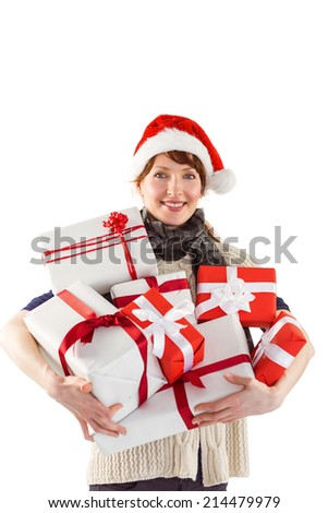 Woman holding lots of presents on white background