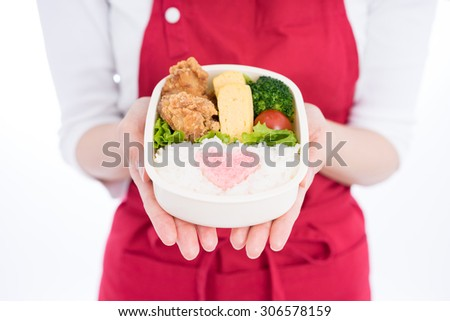 woman holding lunch box isolated on white background - stock photo