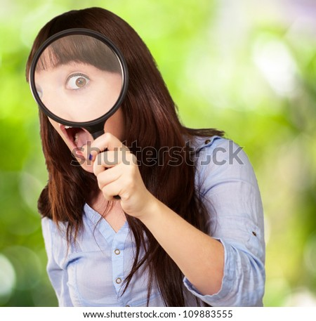 Woman Holding Magnifying Glass, Outdoor - stock photo