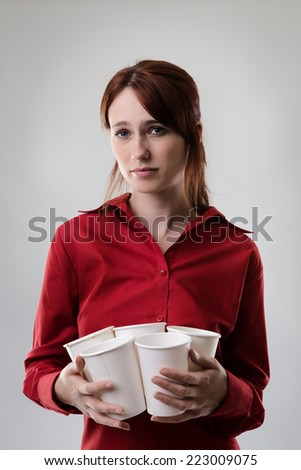 woman holding many take away paper coffee cups