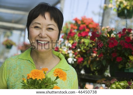 Woman Holding Marigolds
