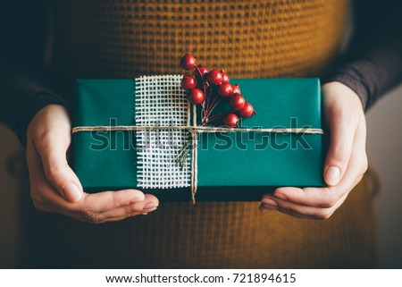 Classy christmas gifts box presents on stock photo 221664037 woman holding modern christmas present gift negle Gallery