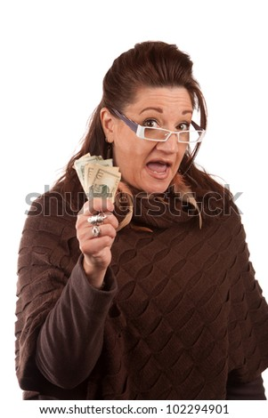 Woman holding money in her hand and shouting or cheering isolated on white.  A great concept for auction bidding or even shopping. - stock photo