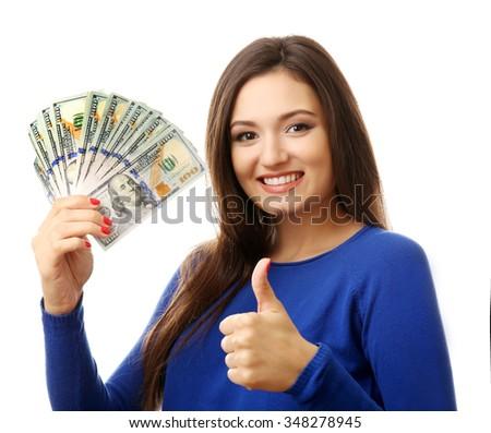 Woman holding money isolated on white - stock photo