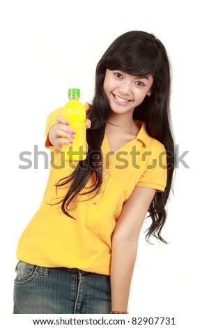 Woman holding orange juice smiling showing orange juice product isolated over white background - stock photo