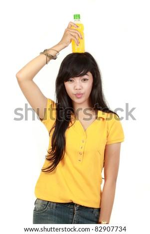 Woman holding orange juice smiling showing orange juice product up on his head. isolated over white background - stock photo
