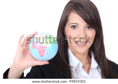 woman holding out world globe - stock photo