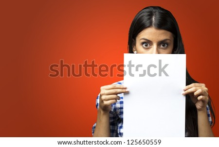 Woman Holding Paper against a red background - stock photo