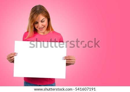 Woman holding paper blank in her hands.