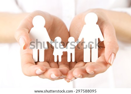 Woman holding paper family close up