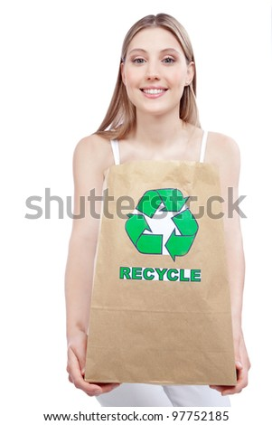 woman holding paper recycling bag - stock photo