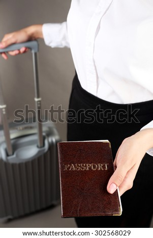 Woman holding passport close up - stock photo