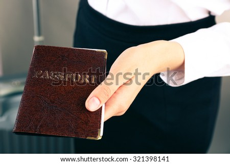 Woman holding passport close up