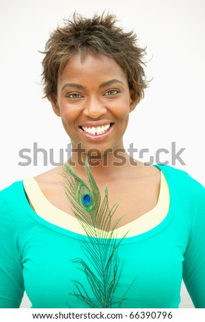 Woman holding peacock feather - stock photo