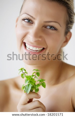 woman holding peppermint sprig - stock photo