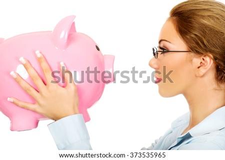 Woman holding piggy bank. - stock photo