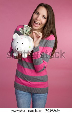 Woman holding piggy bank money - stock photo