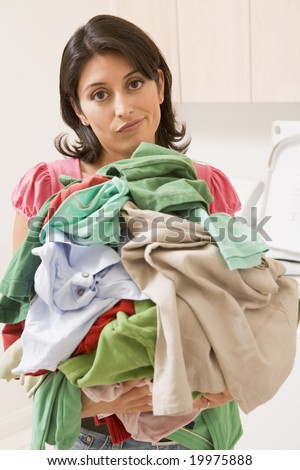 Woman Holding Pile Of Laundry - stock photo