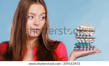 Woman holding pills. Girl female with stack of tablets. Drug addict and health care concept. Overdose.