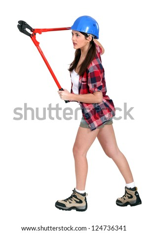 Woman holding pliers - stock photo