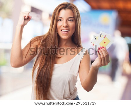 woman holding poker-cards - stock photo