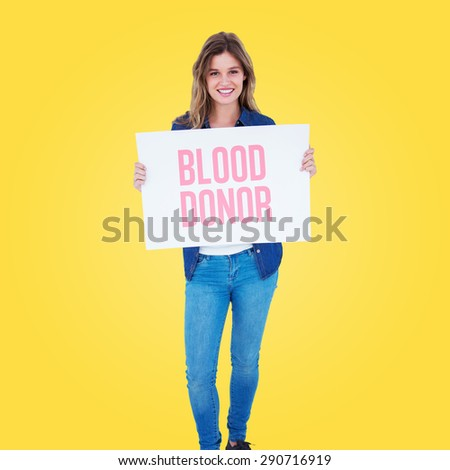 Woman holding poster against yellow vignette - stock photo