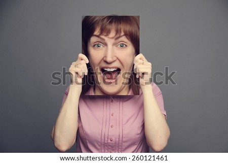 woman holding poster with emotion