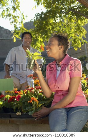Woman holding potted plant - stock photo
