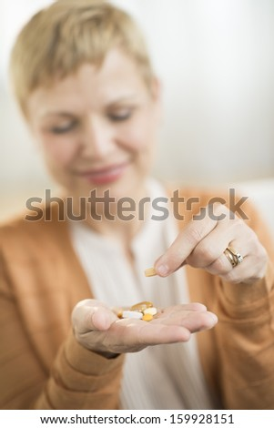 Woman holding prescription medicine in hand