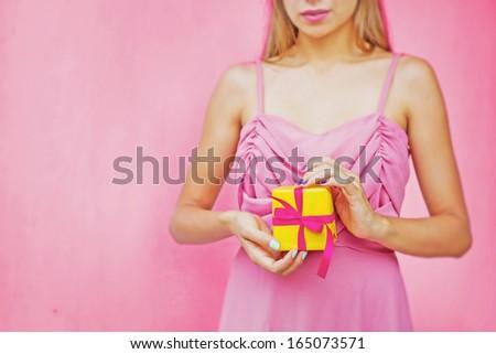 woman holding present (focus on present) - stock photo