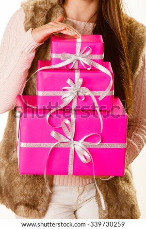 Woman holding presents box making gift in christmas time. Xmas concept.